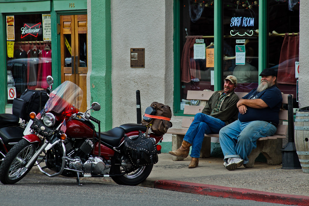 Two men and motorbikes In the historic copper mining town of Jerome, Arizona, USA © 2010 Nick Katin