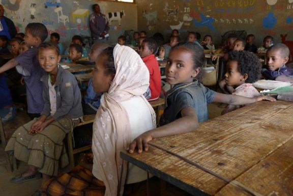 A school in Ethiopia. There are so few resources that the teacher painted teaching resources on his wall to help the kids learn.
