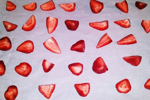 Sliced Strawberries on Cookie Tray lined with parchment paper