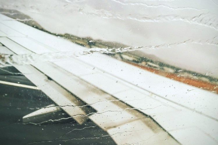 Rain on an airplane window.