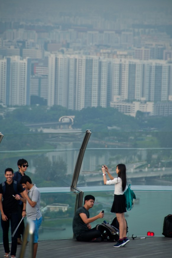 a girl on an observation deck with Singapore in the background