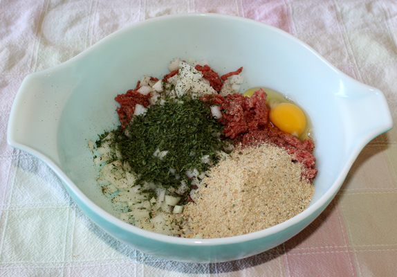 Add ingredients for classic meatballs to mixing bowl