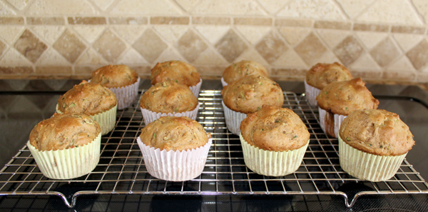 Zucchini muffins cooling on rack