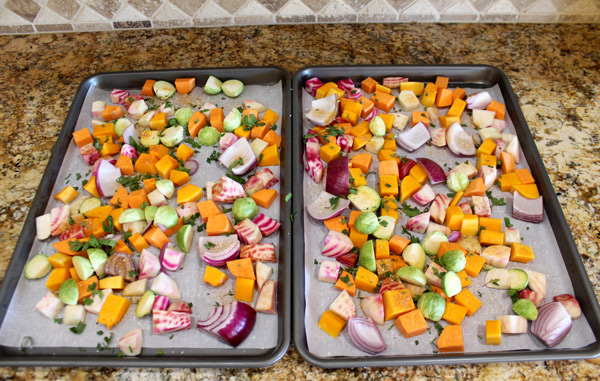 spread the vegetables evenly on the baking sheet