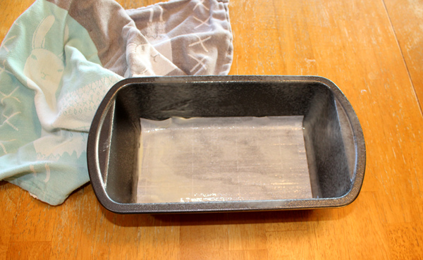 line the bread pan with parchment paper and spray with non-stick spray
