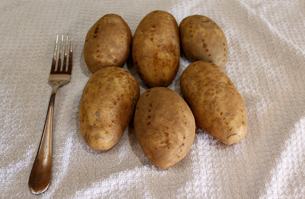 potatoes pricked with a fork