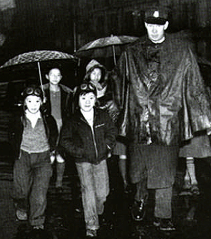 "In 1941, Vancouver witnessed its first wartime blackout.  Windows were covered with tarpaper, and automobile headlights were taped to reveal only a sliver of light.  Fear of a Japanese air assault gripped the city.  This policeman is enforcing the dusk to dawn curfew imposed on Japantown.""  From Vogel, A., Wyse, D. (1993) Vancouver- a history in photographs, Vancouver, BC, Canada: Altitude Publishing Canada Ltd. [Vancouver Pubic Library Special Collections, VPL 1345]"