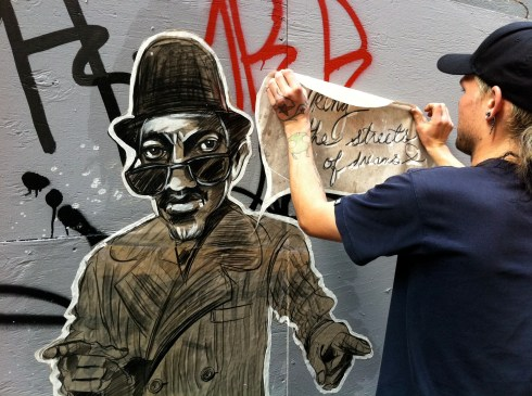 Kevin pasting my portrait of Laurel Aitken one year ago