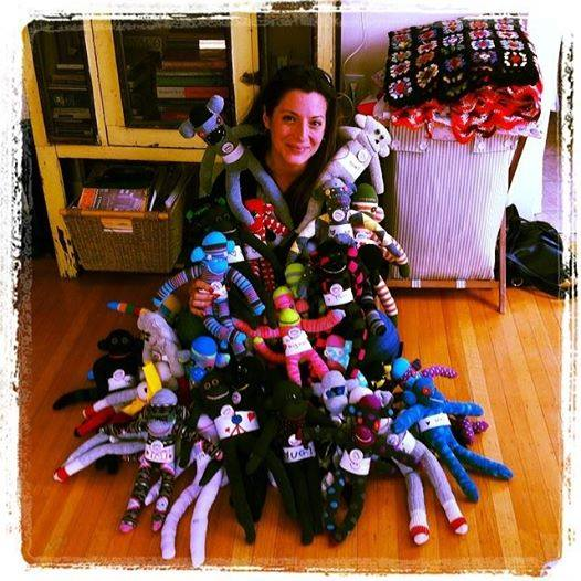 Loretta Cella, Passion Foundation, with sock monkeys headed to South Africa as part of Loretta's work at Patch Centre.