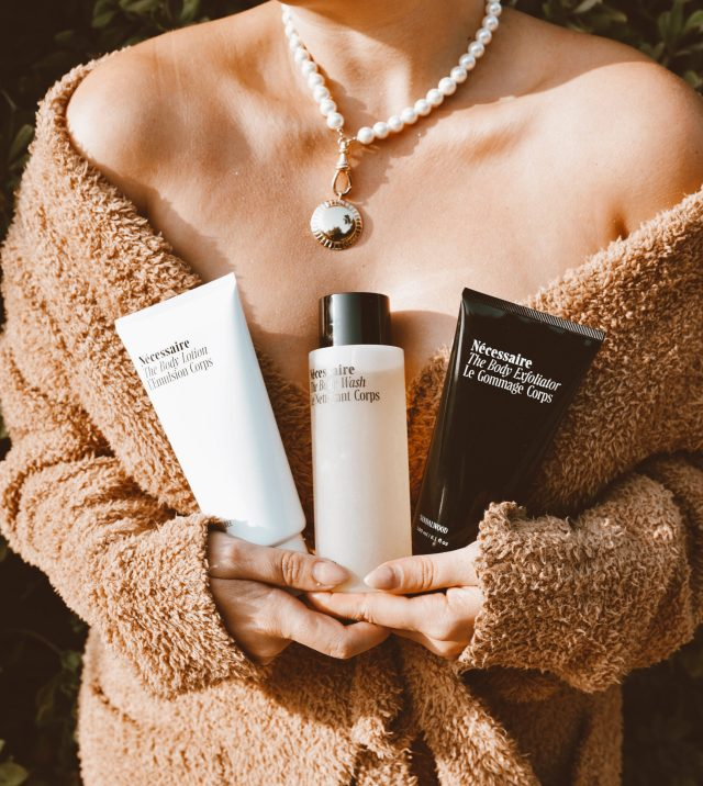 Mother's Day Gifts, San Francisco fashion and lifestyle blogger KatWalkSF hold the Nécessaire The Body Essentials Kit in her SKIMS robe