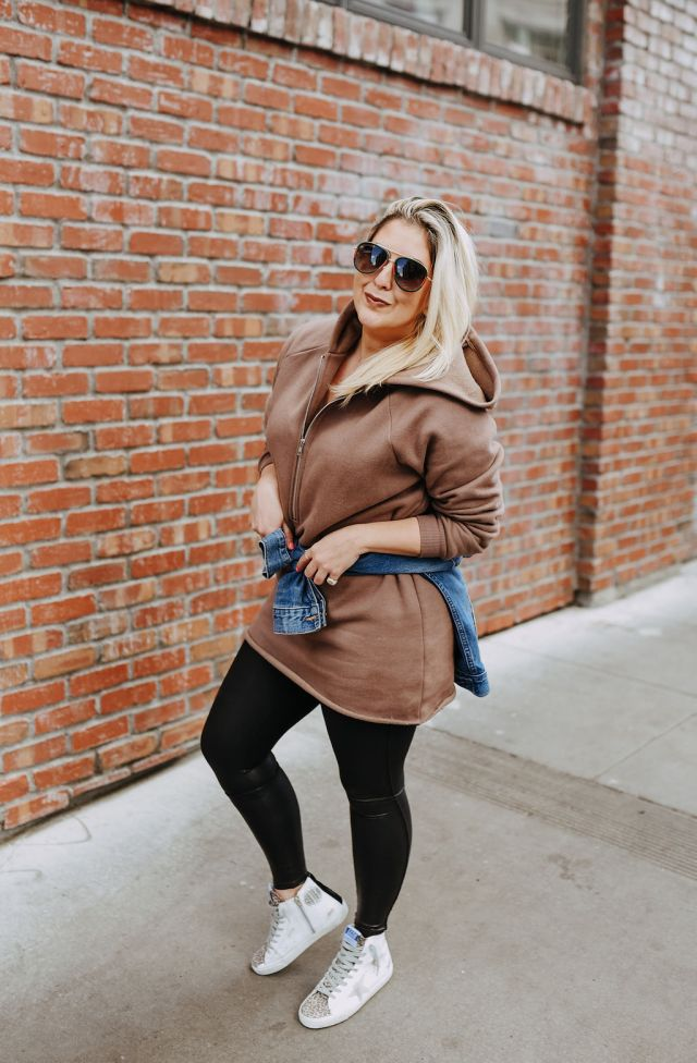 Katwalksf wearing a brown revolve sweatshirt dress, spanx leggings and golden goose francy sneakers.