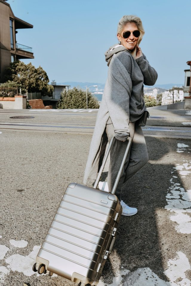 KatWalkSF carrying the The Bigger Carry-On: Aluminum Edition, AWAY Luggage Review