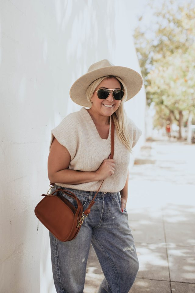 The Fall Madewell Edit, San Francisco blogger KatWalkSF wears the Madewell cropped sweater vest and The Sydney Zip-Top Crossbody Bag