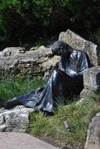 One of the disciples asleep in the garden.