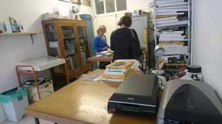 Work desks and filled cabinets