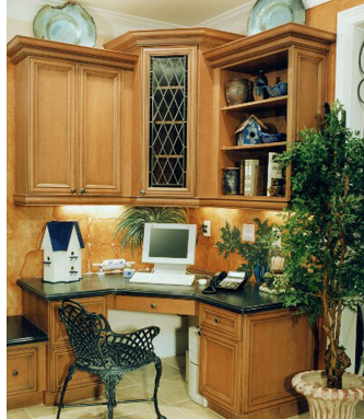 This home office is tucked into a kitchen nook. The plants are good feng shui, but it also needs a mirror since the worker's back is to the room.