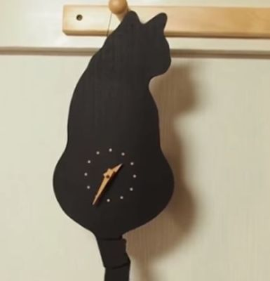 Swinging Tail Pet Wall Clock photo review