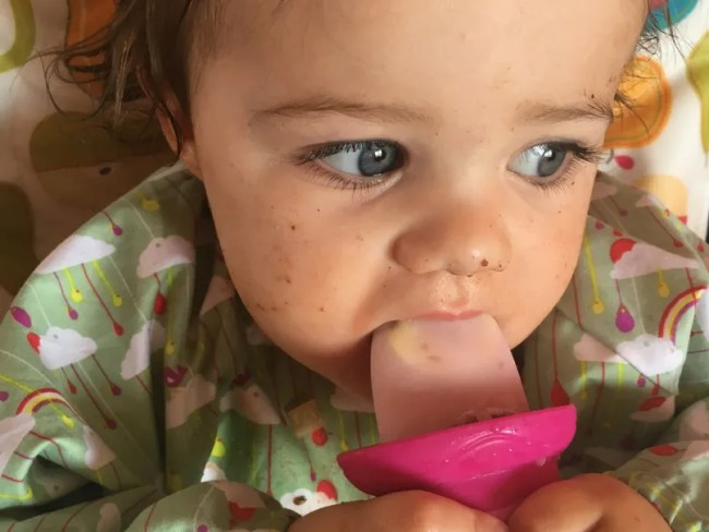 Daisy is 15 months old - Daisy covered in food and loving her dairy free fruit lollies