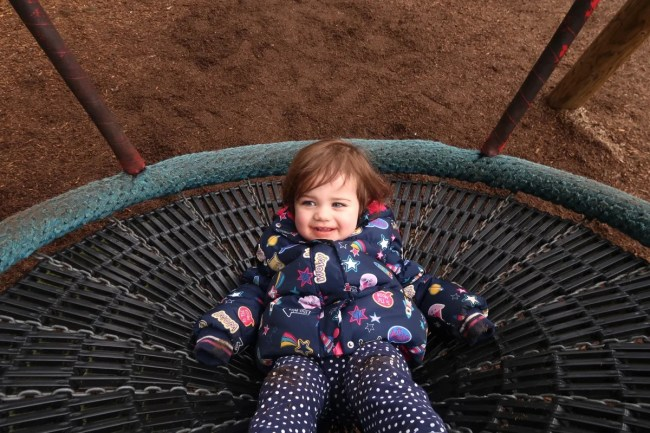 Living Arrows 12/53 - Daisy playing on the swing
