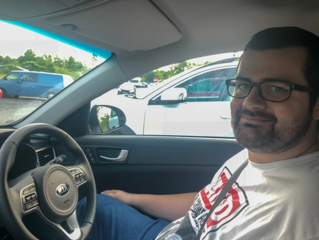 Thomas driving the Kia Optima Sportswagon