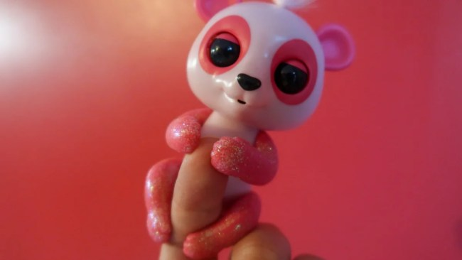 Pink Baby Panda Polly Fingerling on a finger