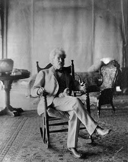 ca. 1900s --- Mark Twain Holding Cat on Lap --- Image by © CORBIS