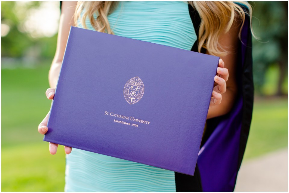 Graduating doctorate student wtih cap and gown | St. Catherine's University in Saint Paul