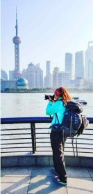 Girl photographing the Oriental Tower