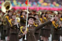 Uniformed participant dance during a mass rally and parade in the capital's main ceremonial square, in Pyongyang. REUTERS/Damir Sagolj