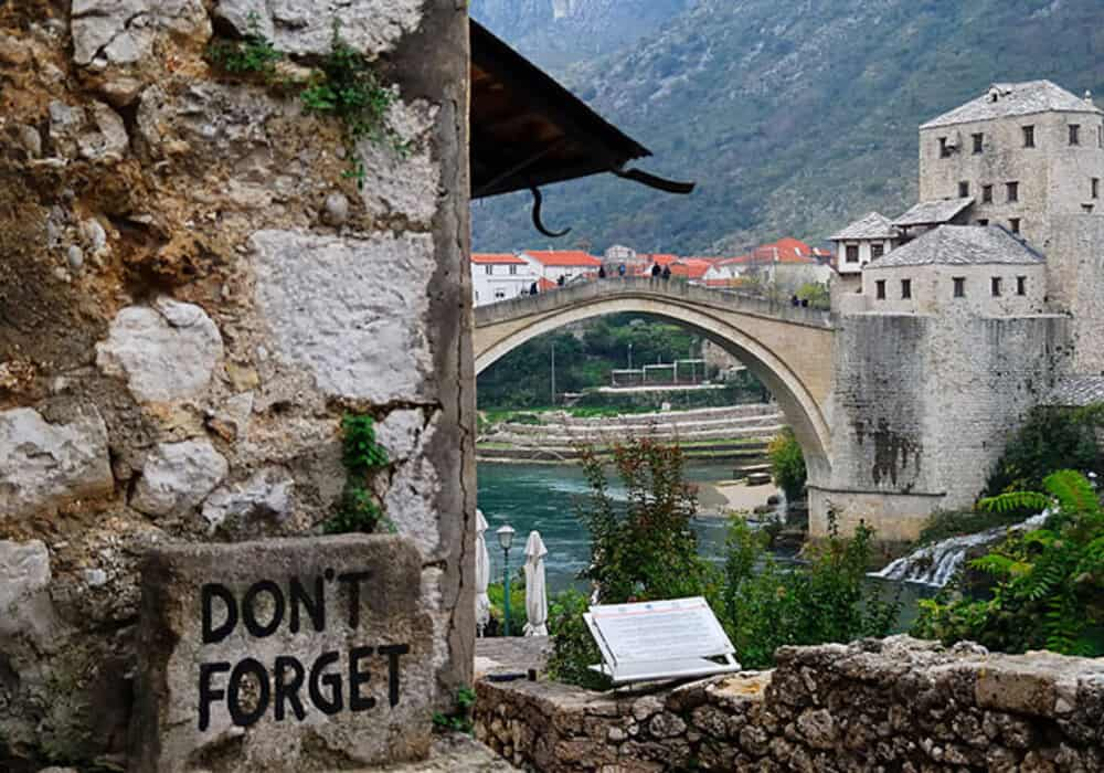 Bosnia and Herzegovina Mostar the Stari Most Dont forget has been written on a stone near the bridge