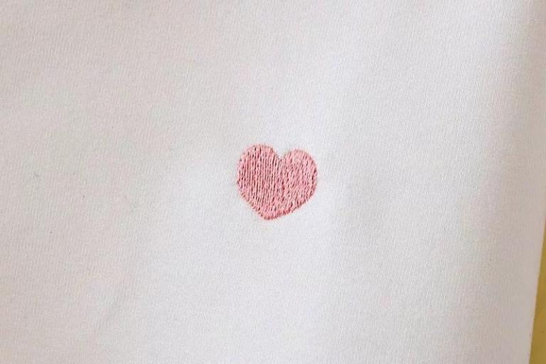 White shirt with pink hearts