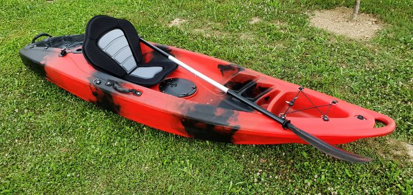 Closeup of red kayak with paddle and seat