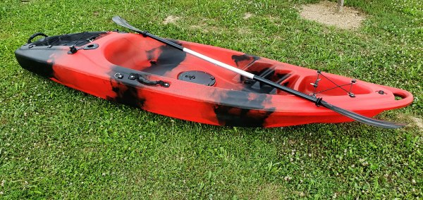 Closeup of red kayak with paddle