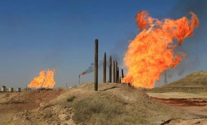 Flames emerge from flare stacks at the oil fields in Kirkuk, Iraq. REUTERS