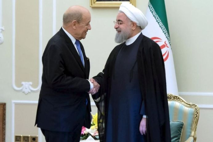 Iranian President Hassan Rouhani shakes hands with French Foreign Affairs Minister Jean-Yves Le Drian, in Tehran, Iran, March 5, 2018. President.ir/Handout via REUTERS