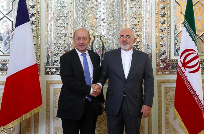 Iranian Foreign Minister Mohammad Javad Zarif shakes hands with French Foreign Affairs Minister Jean-Yves Le Drian in Tehran, Iran, March 5, 2018. Tasnim News Agency/Handout via REUTERS
