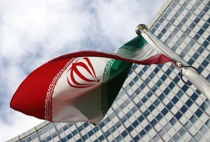 FILE PHOTO: An Iranian flag flutters in front of the United Nations headquarters, during an International Atomic Energy Agency (IAEA) board of governors meeting, in Vienna, March 4, 2015. REUTERS/Heinz-Peter Bader