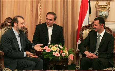 FILE PHOTO: Syria's President Bashar al-Assad (R) meets Ali Larijani(L). REUTERS/Stringer
