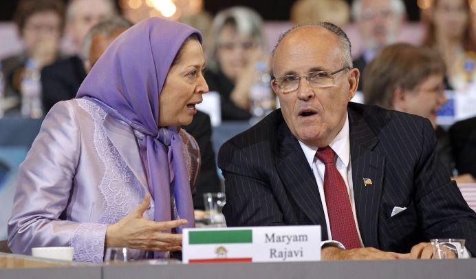 Maryam Rajavi, and Rudy Giuliani take part in a rally in Villepinte, near Paris June 18, 2011. REUTERS