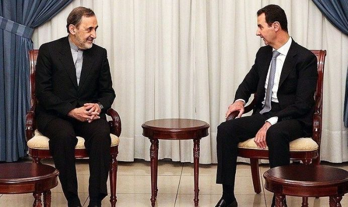 Bashar al-Assad (R) meets Ali Akbar Velayati (L). Author: Fathi Nezam, Tasnim New Agency, Wikimedia commons. (CC BY 4.0)