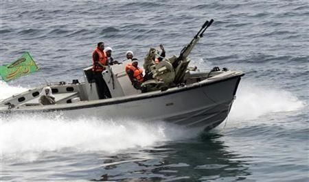FILE PHOTO: An Iranian boat takes part in naval manoeuvres in the Persian Gulf. REUTERS./