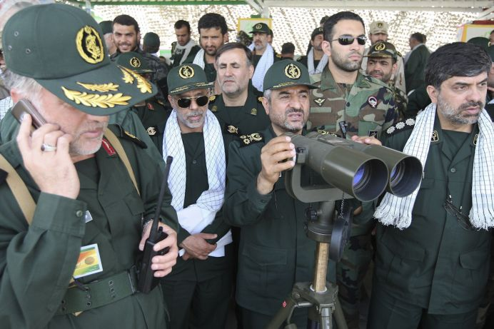 FILE PHOTO: Revolutionary Guards commander Mohammad Ali Jafari (3rd R) monitors an area as he attends a war game in the Hormuz area of southern Iran. Reuters