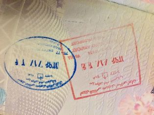 Iran entry (left) and exit stamps issued to a national of Singapore at Imam Khomeini International Airport.