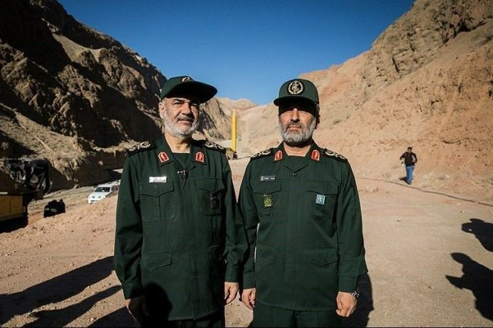 Hosein Salami (L) and Amir Ali Hajizade in Eghtedar -E- Velayat War Game. Source:https://www.tasnimnews.com/fa/media/1394/12/19/1023272/رزمایش-موشکی-اقتدار-ولایت-سپاه Author: Mahmood Hossein. [This file is licensed under the Creative Commons Attribution 4.0 International license.]