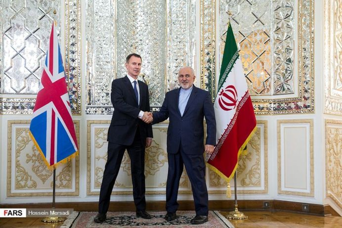 FILE PHOTO: Iran's Foreign Minister Mohammad Javad Zarif meets with British Foreign Secretary Jeremy Hunt, in Tehran, Iran, November 19, 2018. Reuters