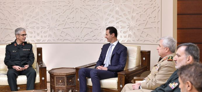 Iran's military chief, General Mohammad Baqeri meets with Syrian President Bashar al-Assad in Damascus, Syria on October 19, 2017. REUTERS