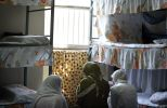 FILE PHOTO: Iranian women prisoners sit at their cell in Tehran's Evin prison . REUTERS./