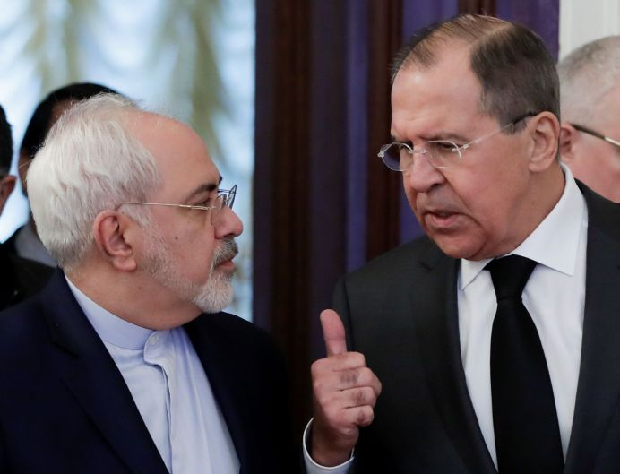 FILE PHOTO: Russian Foreign Minister Sergei Lavrov (R) and his Iranian counterpart Mohammad Javad Zarif. REUTERS/Pavel Golovkin/Pool