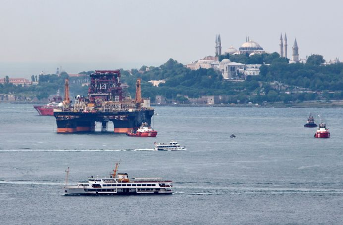 FILE PHOTO: Drilling vessel Scarabeo 9, owned by Italian oil service group Saipem, sails in the Bosphorus in Istanbul, Turkey. REUTERS/YorukIsik