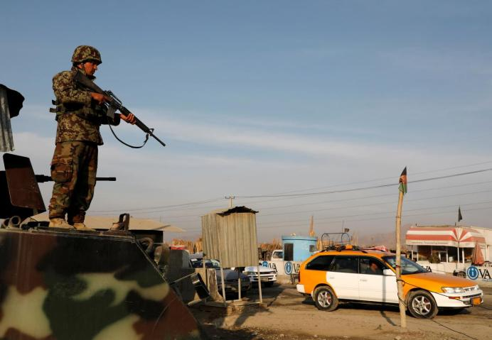 An Afghan National Army (ANA) soldier keeps watch at a check point on the outskirts of Kabul, Afghanistan December 31, 2018. REUTERS/Omar Sobhani